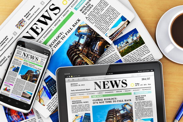 Newspaper with a phone and tablet
